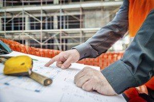Architect checking blueprint